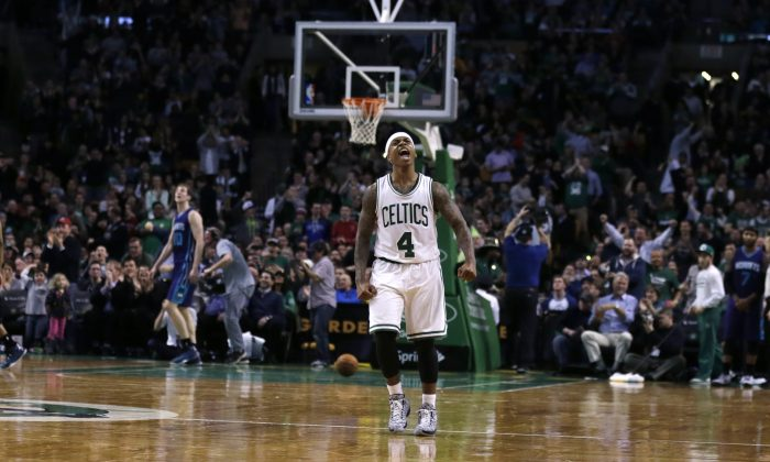 Boston Celtics guard Isaiah Thomas (4) celebrates during the second half of an NBA basketball game in Boston, Friday, Feb. 27, 2015. The Celtics defeated the Hornets 106-98. (AP Photo/Charles Krupa)