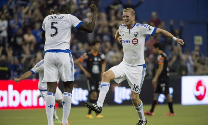 Montreal Impact's Bakary Soumare (L) and Calum Mallace celebrate their draw against Pachuca in CONCACAF Champions League action on March 3, 2015 in Montreal. (The Canadian Press/Paul Chiasson)