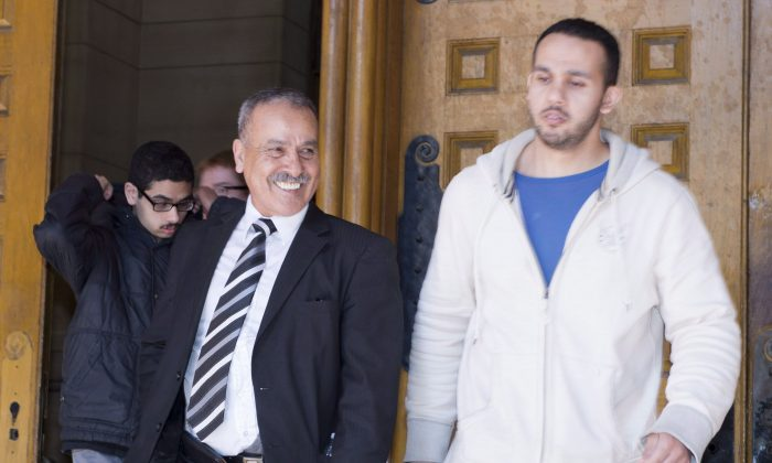 Mohammed Jaser (L), father of Raed Jaser, and another family member father leave court in Toronto on April 23, 2013. Jaser and Chiheb Esseghaier face multiple charges in connection with their alleged plot to derail a Via Rail train travelling from New York to Toronto. (The Canadian Press/Frank Gunn)