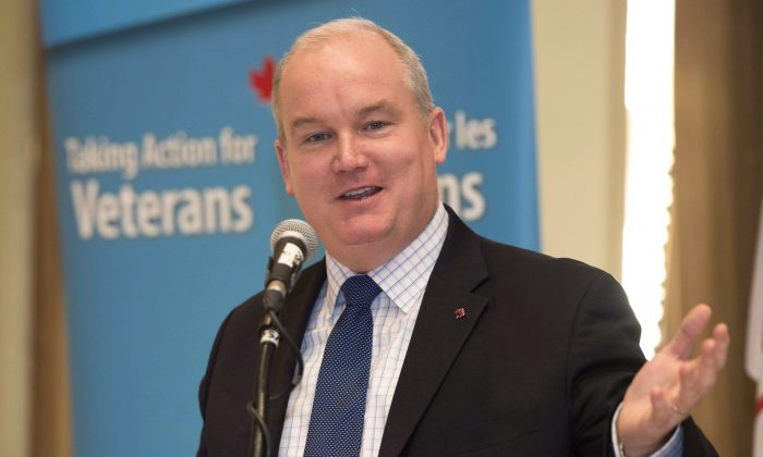 Veterans Affairs Minister Erin O'Toole delivers a speech to the Rotary Club of Toronto in Toronto on Friday January 23, 2015. Veterans Affairs Canada is an increasingly unhappy place with plunging morale and a frazzled workforce, according to a recent federal survey. (The Canadian Press/Frank Gunn)
