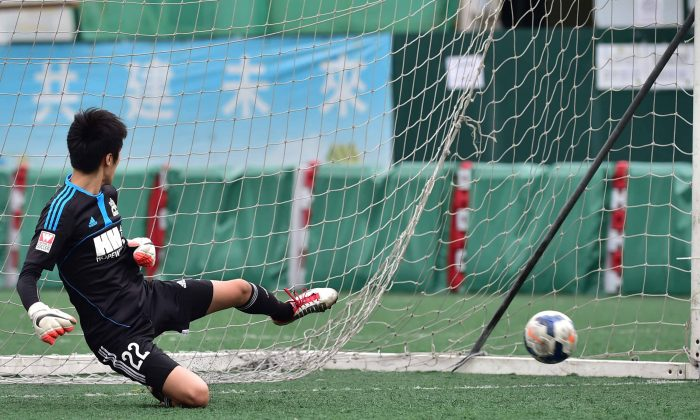 HKFC score to go 1-0 in their 5-2 win against Wan Chai in the HKFA first division match at Valley-6 on Sunday March 1, 2015. (Bill Cox/Epoch Times)