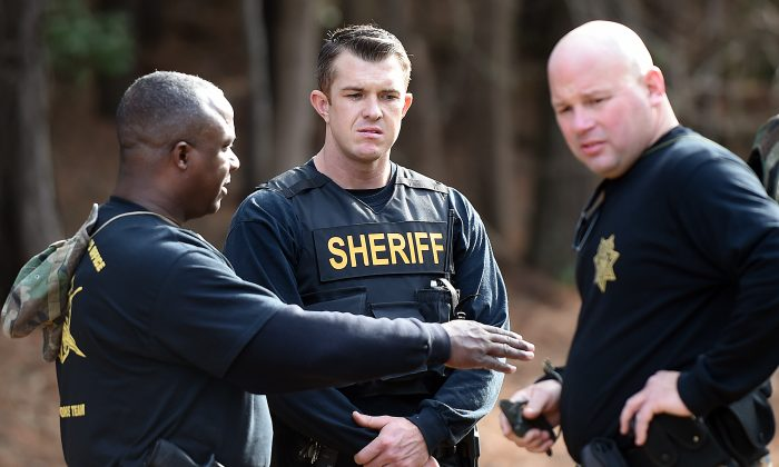 Wilson County Sheriff's Deputies investigate an area near Interstate 95, Monday, March 2, 2015, in Wilson, N.C. (AP Photo/The Wilson Times, Brad Coville)