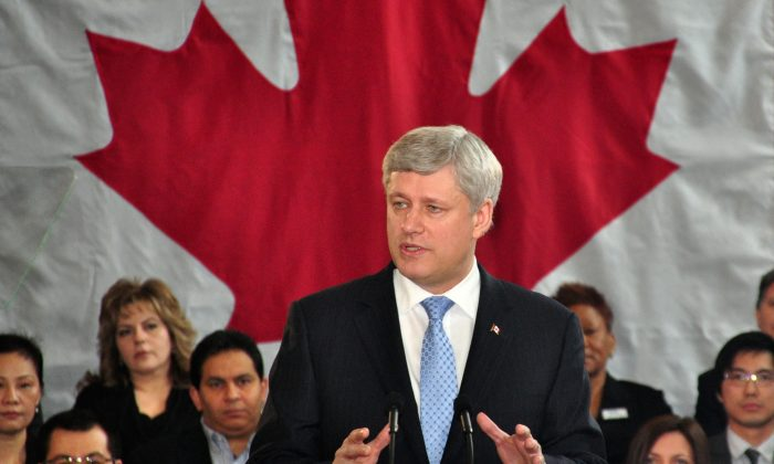 Prime Minister Stephen Harper outlines new legislation to be tabled next week during an event in Toronto on Wednesday, March 4, 2015. The new legislation would remove parole for some crimes. (Allen Zhou/Epoch Times)