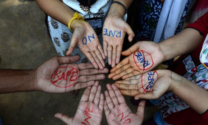 Indian students participate in an anti-rape protest in Hyderabad, India, on Sept. 13, 2013.   (NOAH SEELAM/AFP/Getty Images)