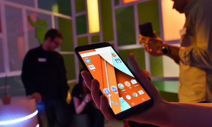 Journalists take a look at Google's newest smartphone nexus 6 during a media preview in New York on October 29, 2014. (Jewel Samad/AFP/Getty Images)
