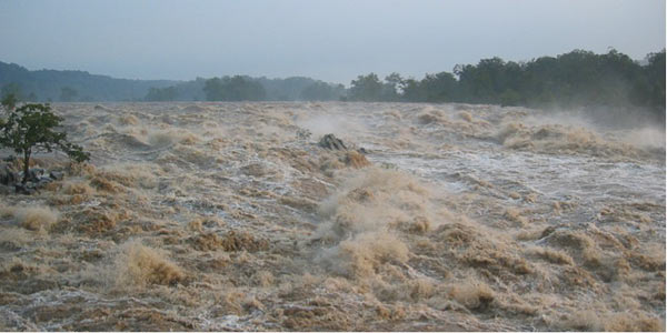 Runoff from Hurricane Isabel floods the Potomac River at Great Falls, Va., carrying sediment eroded from farm fields upstream. Photo by: Paul Bierman.