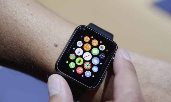 The new Apple Watch is modeled during a media event in Cupertino, Calif. on Sept. 9, 2014. (AP Photo/Marcio Jose Sanchez)