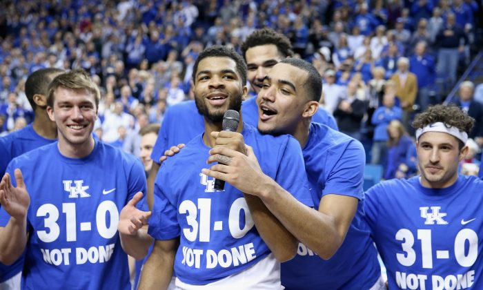Kentucky465528280 Andrew Harrison (center-left) and Trey Lyles (center-right) of the Kentucky Wildcats have been a big part of the team's 31–0 start. (Andy Lyons/Getty Images)
