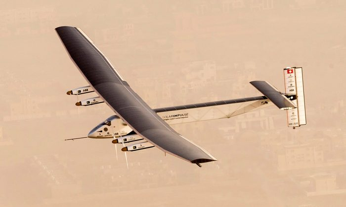 In this handout image supplied by Jean Revillard, Solar Impulse 2, a solar-powered airplane, takes flight as it begins its historic round-the-world journey from Al Bateen Airport, on March 09, 2015 from Abu Dhabi, UAE. The 35,000km journey is expected to last five months and is piloted by Andre Borschberg and Bertrand Piccard of Switzerland. The Solar Impulse 2 is equipped with 17,000 solar cells, has a wingspan of 72 metres, and yet weighs just over 2 tonnes. (Jean Revillard via Getty Images)