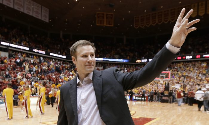 Iowa State coach Fred Hoiberg waves to fans as he walks off the court after his team's NCAA college basketball game against Kansas, Saturday, Jan. 17, 2015, in Ames, Iowa. Iowa State won 86-81. (AP Photo/Charlie Neibergall)