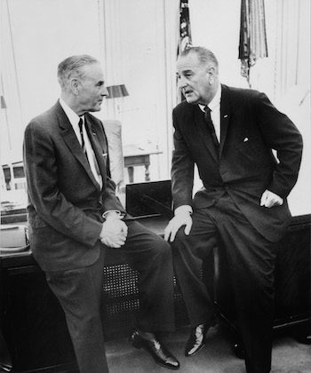 President Lyndon B. Johnson (R) confers in the White House with the U.S. Ambassador to South Vietnam Gen. Maxwell Taylor (L) on Aug. 8, 1965. (AFP/AFP/Getty Images)