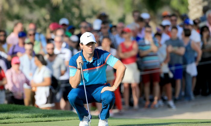 Rory McIlroy of Northern Ireland lines up a putt on the par 3, 15th hole during the final round of the 2015 Omega Dubai Desert Classic on the Majlis Course at the Emirates Golf Club on February 1, 2015 in Dubai, United Arab Emirates. (David Cannon/Getty Images)