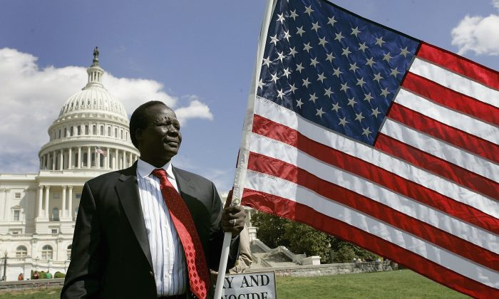 Former Sudanese slave Simon Deng stands in front of the U.S. Capitol after he completed a 300-mile walk from New York to Washington to shed light on the genocide and modern-day slavery in Sudan, on April 5, 2006. (Mark Wilson/Getty Images)