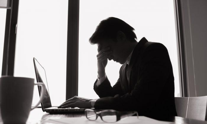 Stressed businessman. (Shutterstock*)