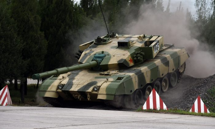 One of China's modern tanks crosses an obstacle during a driving demonstration at the People's Liberation Army Armored Forces Engineering Academy in Beijing on July 22, 2014. (Greg Baker/AFP/Getty Images)