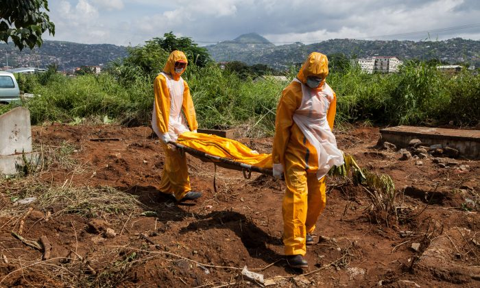 A team of funeral agents specialised in the burial of  victims of the Ebola virus. (Florian Plausheur/AFP/Getty Images)