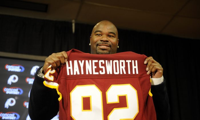 Albert Haynesworth was all smiles after signing a 7-year contract worth approximately $100 million with the Washington Redskins. The relationship would soon sour. (Mitchell Layton/Getty Images)