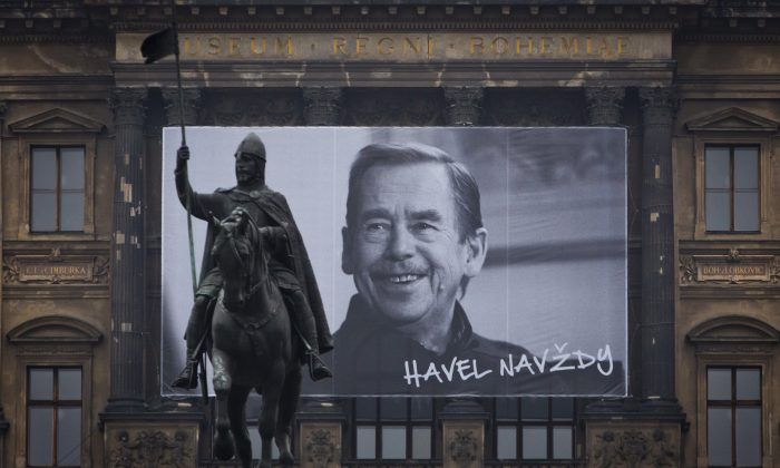 "A large portrait of former President of Czechoslovakia and Czech Republic Vaclav Havel with the sign ""Havel Forever"" hangs on the National Museum behind the St. Wenceslas statue on the 25th anniversary of the Velvet Revolution in Prague, Czech Republic, on Nov. 17, 2014. (Matej Divizna/Getty Images)"