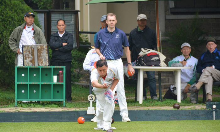 Mobin Yau (delivering) of the Hong Kong Cricket Club on his way to defeating Derek Wyllie from the Hong Kong Football Club in the final of the National Champion of Champions Singles at United Services Recreation Club last Sunday, March 8, 2015. (Stephanie Worth)
