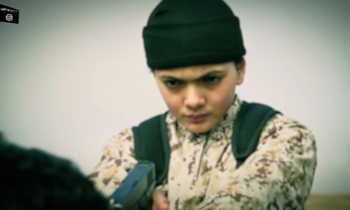 A video posted by ISIS apparently shows a child executing an alleged Israeli spy. (ISIS video screenshot taken by Epoch Times)