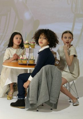 Models play on the runway at the Anais & I show during petitePARADE/Kids Fashion Week at Bathhouse Studios in New York City on Feb. 28, 2015. (Monica Schipper/Getty Images for petitePARADE)
