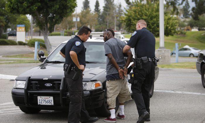 San Bernardino police officers arrest a man on July 12, 2012.