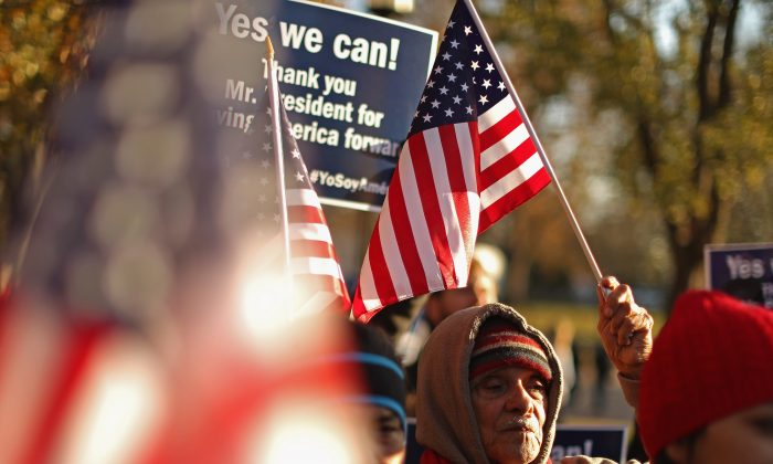 About 100 people gather to rally in support of President Barack Obama's executive action on immigration policy in Lafayette Square across from the White House in Washington, D.C., on Nov. 21, 2014. (Chip Somodevilla/Getty Images)