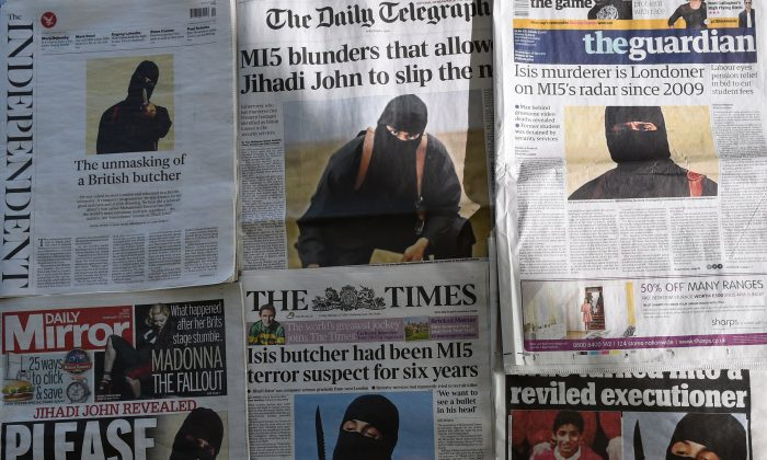 "British newspapers shows the front-page headlines and stories regarding the identification of the masked Islamic State group militant dubbed ""Jihadi John"", Mohammed Emwazi from London. Photographed in London on February 27, 2015. (Daniel SorabjiAFP/Getty Images)"