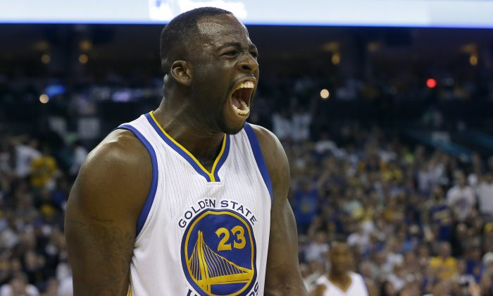 Golden State Warriors forward Draymond Green (23) yells after scoring against the Los Angeles Clippers during the second half of an NBA basketball game in Oakland, Calif., Sunday, March 8, 2015. (AP Photo/Jeff Chiu)