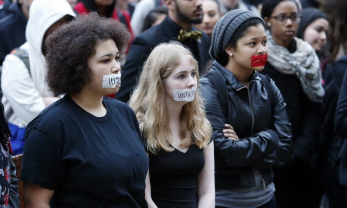 Students at the University of Oklahoma protest racist comments made by the Sigma Alpha Epsilon fraternity on campus, on Monday, March 9, 2015 in Norman, Okla. University President David Boren ordered the fraternity's house to be vacated by midnight Tuesday. (AP Photo/The Oklahoman, Steve Sisney)