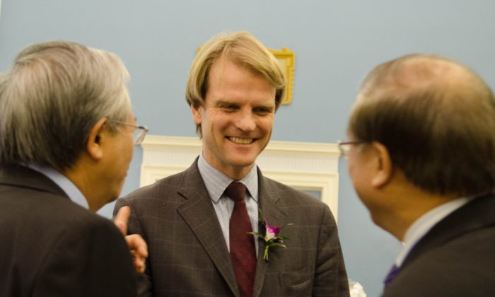 Immigration Minister Christopher Alexander chats with other guests at Taiwan night at the Fairmont Chauteau Laurier hotel in Ottawa on Wednesday night. (Matthew Little/Epoch Times)