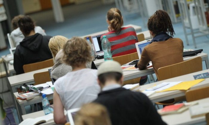 Students study with their laptop computers in the Pedagogical Library at the Freie Universitaet university on September 20, 2011 in Berlin, Germany. (Sean Gallup/Getty Images)