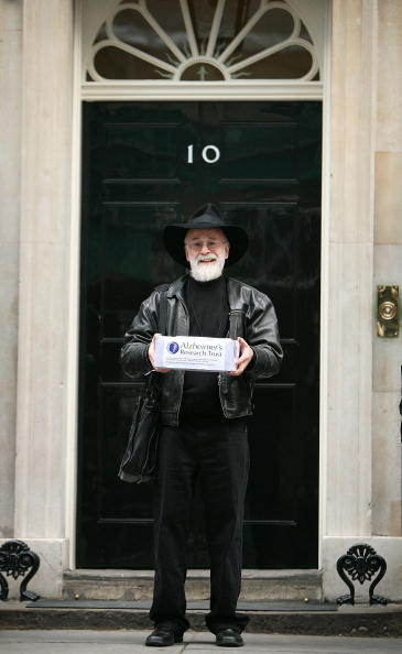 Author Terry Pratchett poses for photographs outside Number 10 Downing Street on November 26, 2008 in London. Mr Pratchett, who was recently diagnosed with Alzheimers, handed in a petition on behalf of the Alzheimer's Research Trust calling for an increase in government funding for dementia research. (Photo by Peter Macdiarmid/Getty Images)