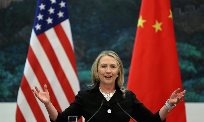 U.S. Secretary of State Hillary Rodham Clinton speaks during at an unrelated joint conference with Chinese Foreign Minister Yang Jiechi at the Great Hall of the People in Beijing, China, Wednesday, Sept. 5, 2012.  (AP Photo/Feng Li, Pool)