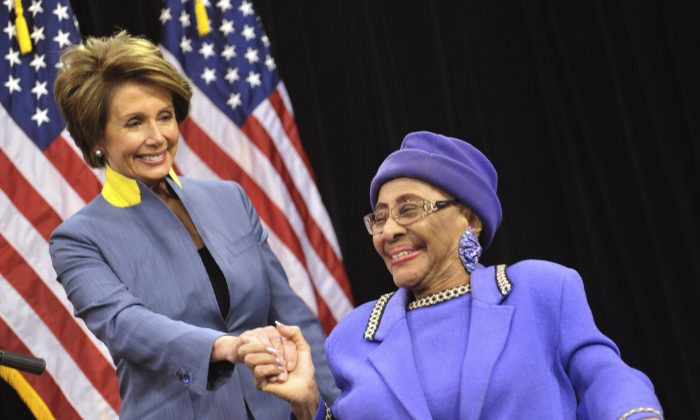 In this March 3, 2012 photo, House Democratic Leader Nancy Pelosi, left, visits with Rev. Willie T. Barrow before a press conference at Operation PUSH headquarters in Chicago. (AP Photo/Sun-Times Media, Al Podgorski)