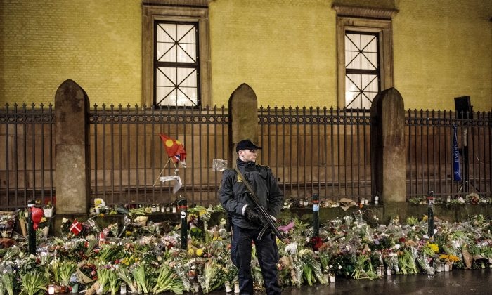 An armed police officer guards outside the Jewish synagogue during a memorial service in Copenhagen on Feb. 24, 2015, for Dan Uzan and Finn Noergaard, who were killed during the twin terrorist attacks the previous week in Copenhagen. (Bax Lindhardt/AFP/Getty Images)
