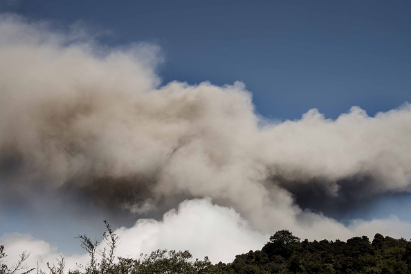 Ash spewed from the Turrialba volcano heads towards San Jose and its surroundings on March 13, 2015. The volcano showered nearby towns with ash forcing evacuations from areas in its vicinity  about 80 km from the crater. AFP PHOTO / EZEQUIEL BECERRA        (Photo credit should read EZEQUIEL BECERRA/AFP/Getty Images)