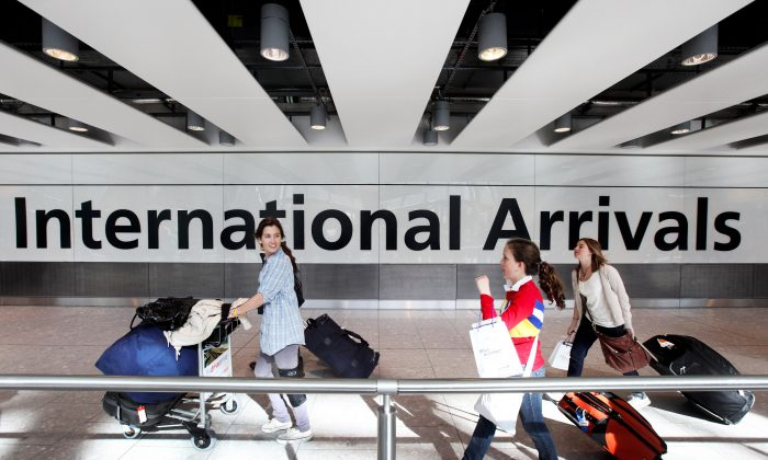 Passengers arrive in Heathrow airport's Terminal 5 on April 21, 2010 in London, England. (Oli Scarff/Getty Images)