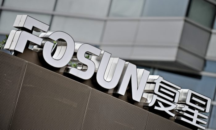 The logo of Fosun International in front of the company's headquarters in Shanghai. (Philippe Lopez/AFP/Getty Images)