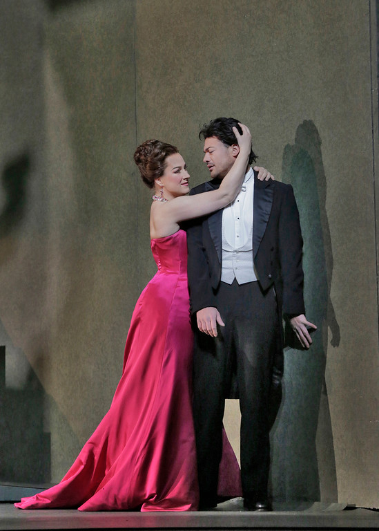 Manon (Diana Damrau) seduces her first lover des Grieux (Vittorio Grigolo) to join her in a licentious life. (Ken Howard/Metropolitan Opera)