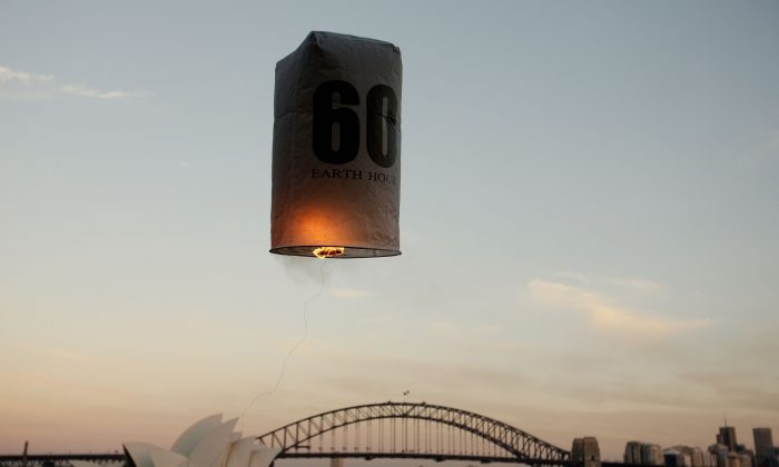 Seven lanterns representing the seven continents of the world are released over Sydney Harbour, in a countdown to Earth Hour in 2010, in Sydney, Australia. Earth Hour 2015 is focused on the impact of global warming on rural communities and food production this year. (Brendon Thorne/Getty Images for WWF