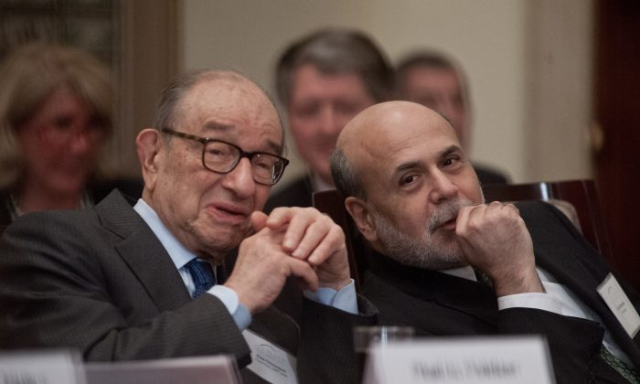 U.S. Federal Reserve chairman Ben Bernanke (R) speaks with former chairman Alan Greenspan during a ceremony marking the centennial of the founding of the Federal Reserve in Washington on Dec. 16, 2013. (Nicholas Kamm/AFP/Getty Images)