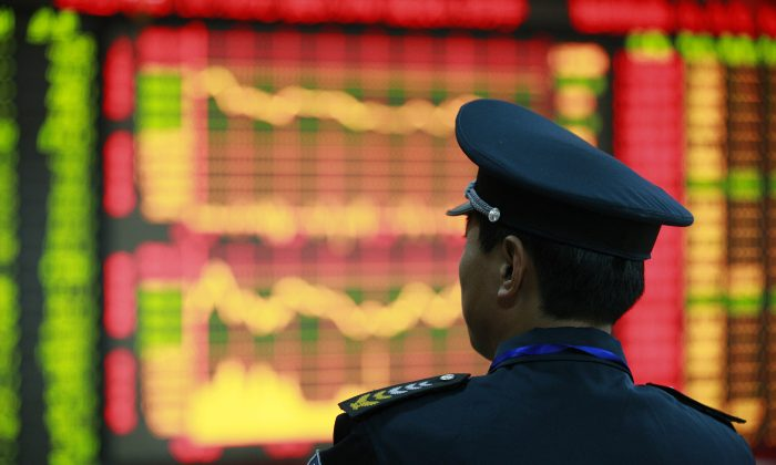 A guard looks around at a securities exchange in Huaibei, central China's Anhui province. (STR/AFP/Getty Images)