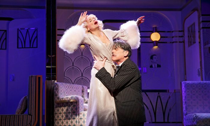"Producer Oscar Jaffee (Peter Gallagher) desperately needs star Lily Garland (Kristen Chenowith) to appear in his new production, in the wonderful musical ""On the Twentieth Century."" (Joan Marcus)"
