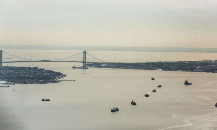 The Verrazano-Narrows Bridge and New York Harbour are seen from the 100th floor of One World Trade Center on February 12, 2014 in New York City. The Harlem Globetrotters toured the 100th floor of the World Trade Center and gave away 104 tickets to an upcoming show, to represent the 104 floors of the building. (Photo by Andrew Burton/Getty Images)