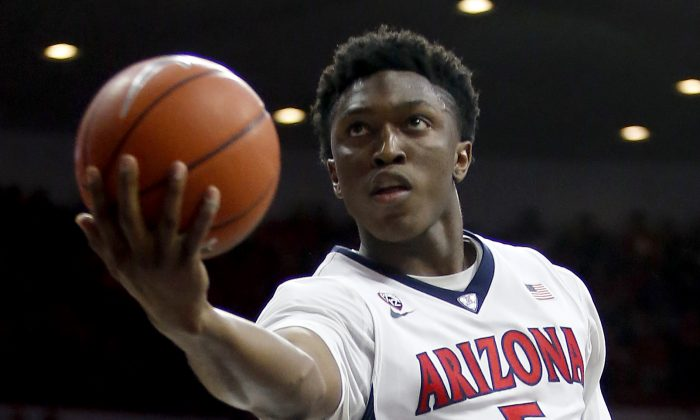 Arizona forward Stanley Johnson (5) shoots against Southern California during the second half of an NCAA college basketball game, Thursday, Feb. 19, 2015, in Tucson, Ariz. (AP Photo/Rick Scuteri)