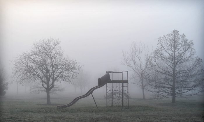 Thick fog blankets the playground at Lake Wichita Park in Wichita Falls, Texas, on March 11, 2015.  (AP Photo/Wichita Falls Times Record News, Torin Halsey)