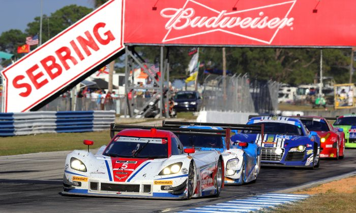 Action Express will be back after winning the 2014 Prototype championship and the North American Endurance Cup.  The Ganassi #01 (second in line) will want to defend its 2014 Sebring win. (Chris Jasurek/Epoch Times)