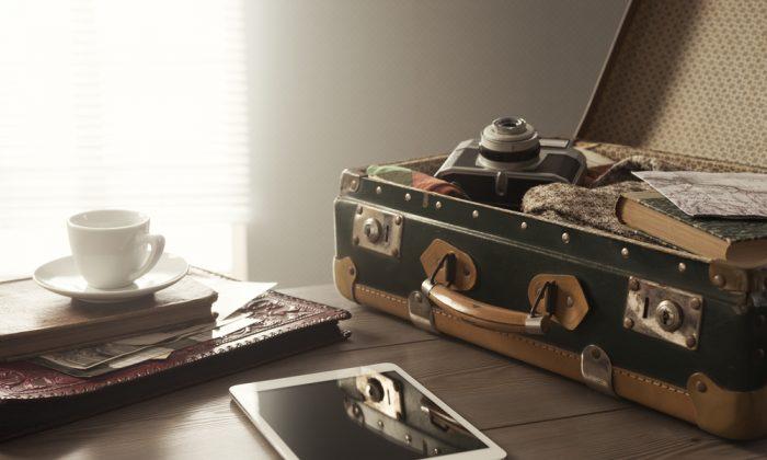 Traveler's suitcase via Shutterstock*