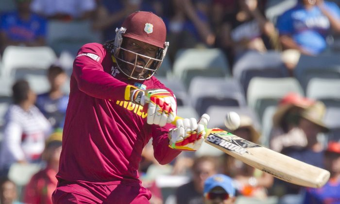 West Indies batsman Chris Gayle plays a shot during the 2015 Cricket World Cup Pool B match between the West Indies and India in Perth on March 6, 2015. (AFP/Tony Ashby)